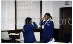 Two Female Cadets Salute Each Other In Class