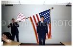 [Cadet Poses in Front of the American Flag]