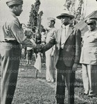 [Cadet Captain Cortez W. Peters, Jr. of Company B, Receives General Ely trophy]