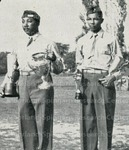 [Cadet Captain Cortez W. Peters, Jr. of Company B poses for award with a fellow cadet]