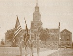 The Color bearers, followed by a company of ROTC cadets, pass in review before Colonel Trevor W. Swett's reviewing party.