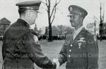Col. James J. Carnes congratulates Capt. Lucius E. Young