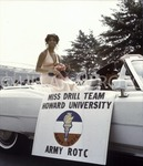 [Miss Drill Team Howard University, Army ROTC Rides in Car During Homecoming Parade]