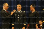 [Cadet Bennett Recieves His Bars from his parents at the 2016 Army ROTC Commissioning Ceremony]