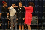 [Cadet Parker Recieves His Bars from her family at the 2016 Army ROTC Commissioning Ceremony]