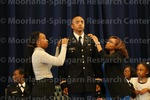 [Cadet Young Recieves Bars from her family at the 2016 Army ROTC Commissioning Ceremony]