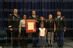 [Cadet Young poses with family and ROTC leadership at the 2016 Army ROTC Commissioning Ceremony]