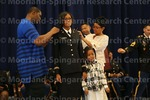 [Cadet Bennett Recieves Bars from her family at the 2016 Army ROTC Commissioning Ceremony]