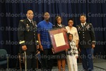 [Cadet Bennett with family and ROTC leadership at the 2016 Army ROTC Commissioning Ceremony]