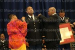 [Cadet Donte Jones Recieves His Bars from his parents at the 2016 Army ROTC Commissioning Ceremony]