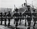 The George F. Welch Memorial Drill Team gallantly onward