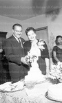 Thurgood Marshall and his wife cutting a cake