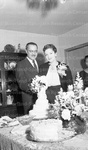 Thurgood Marshall and his wife cutting a cake 2