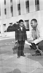 At the District Court. Private Barnes of the Metropolitan Police with his son, charged with killing a colored truck driver. October 1955.