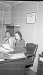 Attorney William Bryant and Mrs. Borna Whitted at attorney office in Front Royal School case. December 1958.