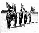 Standards of Companies A, B, C, and D of 100th Infantry Battalion, 442nd Regiment, 34th Division, flying battle streamers awarded through presidential citation just tied on by General Mark Clark, Commanding General. 5th Army. July 1944