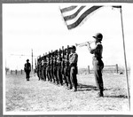 Japanese American soldiers plays taps