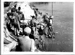 Chinese troops cross the Shweli River near Nankham on their way into the city. 16 January 1945