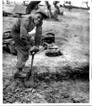 Lt. John W. Rogers, Chicago, Ill. Digs a slit trench