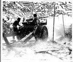 Two Japanese American soldiers firing