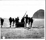 [Soldiers of the 1st Filipino Infantry battalion disembark from ship]