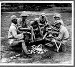 U.S. Troops somewhere in India teach Chinese Fighters on the use of modern weapons. 1942
