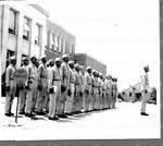 Exchanging their rifles for schoolbooks, these soldiers, each of whom scored 115 or higher on the Army General Classification Test, report to Agricultural and Technical College Star unit, at Greensboro, N.C. for classification before being assigned to a college for further study.