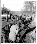 [African American soldiers build trench]