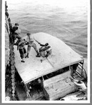American troops in Liberia [working on boat]