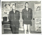 Brigadier General Benjamin O. Davis, Sr.; Lt. Col. Benjamin O. Davis, Jr.; Father and son, the outstanding negro military figures in America, posed for the Tuskegee Army Flying School cameraman. Brig. Gen. Benjamin O. Davis, Sr., (Left) recently made an official tour of inspection at the famed negro air base. While here he was the guest of his son Lt. Col. Benjamin O. Davis, Jr. (right) the idol of the personnel of this command.