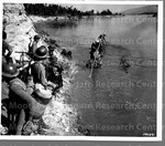 Chinese troops are shown crossing Shweli River near Nankkam, Burma, on their way into the city. January 16, 1945
