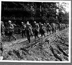 Japanese American Infantry men hike