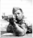 On the Range_ This Negro Marine recruit trainee his eye on the firing line's target in preparation for his future role on the fighting front.