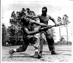 The Know How_ Corporal Arvin Lou Ghazlo (right), shows Private Ernest C. Jones, of Brooklyn, NY., how to disarm an enemy while unarmed yourself. The scene is Camp Lejeune, N.C., where Colored Marines receive their basic training.