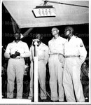 Negro Army Quartet Brings Down House at Marine Smoker_ At a smoker given at a South Pacific base by a Marine Air Wing for soldiers, sailors, and Marines, this quartet of soldiers furnished the vocal entertainments.