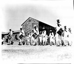 All negro drum and bugle corps goes through its paces during a regimental review here at the U.S. Naval Training Station