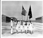 A negro bugler and color-guard rehearse their part for one of the routine reviews held at Camp Robert Smalls, all-negro camp here at the U.S. Naval Training Station