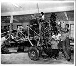 Negro bluejackets at work on 1929 Travel-Air Biplane