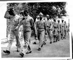 Soldiers of a U.S. Army Port Battalion somewhere in India march in body to hear Mass on Easter Sunday.