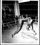 A bout at the Empire Red Cross Club in Oran, North Africa.