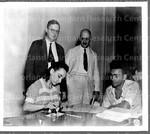 Registration Day, Nov. 20, 1940 at San Juan, P.R. Grammar School, as two older officials look on