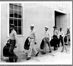 Cadets leaving warehouse with uniforms. Hdqs. 4th Service Command, Atlanta, Ga.