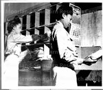 [Members of the Army Women's Nursing Corps sorting packages]
