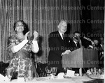 Ferebee, Dr. Dorothy B standing and applauding man at podium