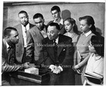 Dr. Rayford W. Logan with students in Holiday Magazine, February 1950