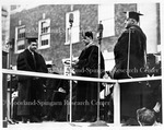 Dr. Jones, left, receives Honorary Degree, Commencement,1937 Dr. M.W. Johnson, Center Dean O.W. Holmes on right.
