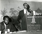 J. Clay Smith, Jr., speaking at a podium