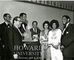J. Clay Smith, Jr. with Wiley A. Branton Sr., A. Leon Higginbothom, Arthur Burnette, Catherine Coleman, Carlene Reid, and Herbert Reid, Sr. (2 images)