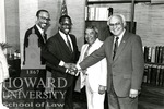 J. Clay Smith, Jr. with unidentified individuals