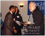 J. Clay Smith, Jr. receiving award from Michael J. Morrison, S.J. and Michael Proterra, S.J.